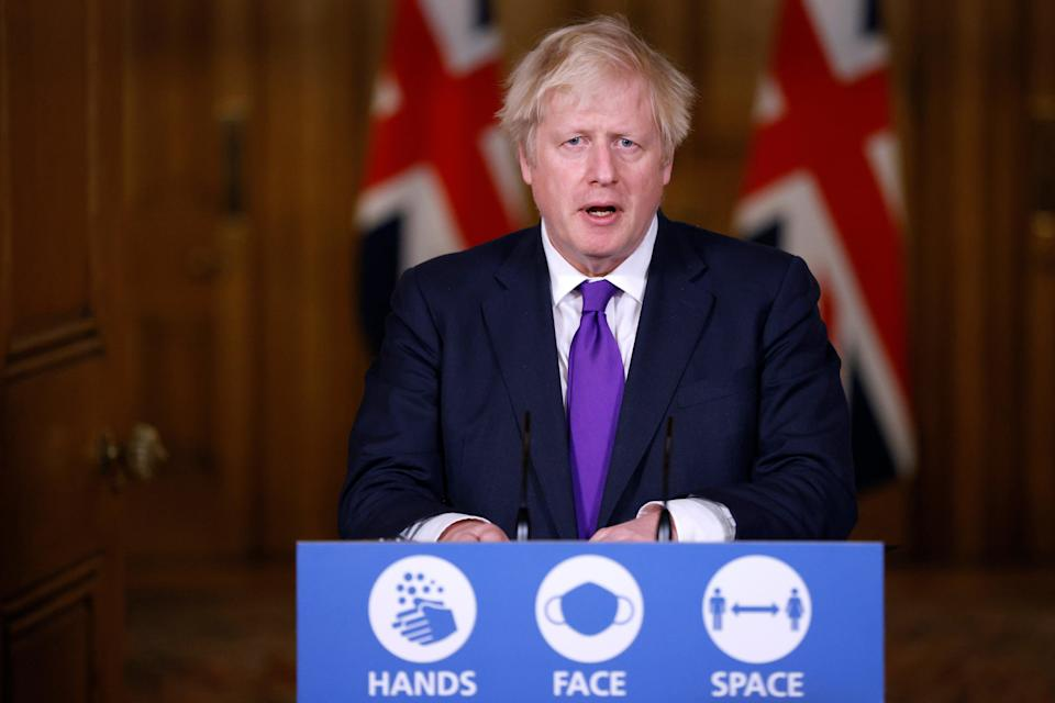 <p>Britain's PM Johnson attends a news conference in London</p> (REUTERS)