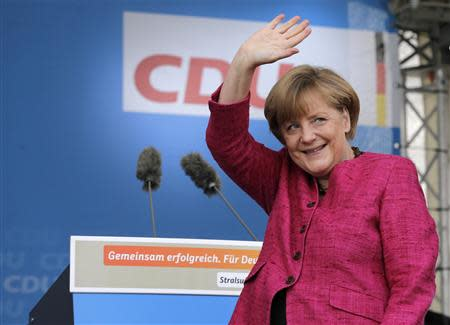 German Chancellor Merkel waves to supporters during a CDU election campaign rally in Stralsund