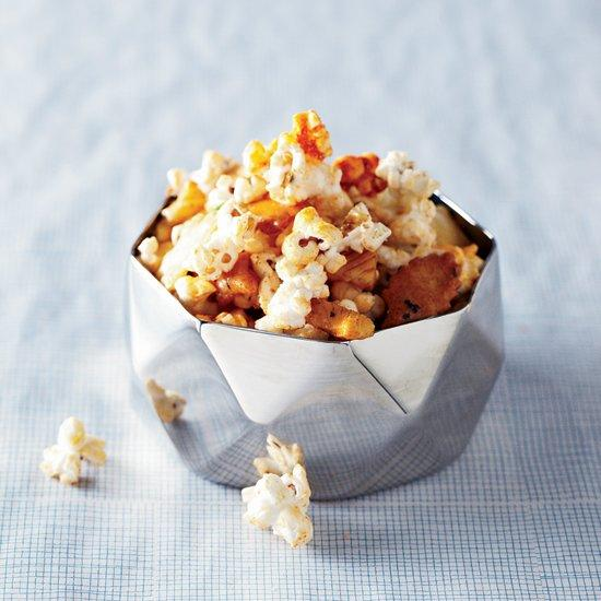 """<p>Bring <a href=""""https://www.foodandwine.com/recipes/smoky-popcorn"""" target=""""_blank"""">gourmet popcorn</a>. Flavored oils, <a href=""""https://www.foodandwine.com/recipes/dill-pickle-popcorn"""" target=""""_blank"""">spices</a> and <a href=""""https://www.foodandwine.com/fwx/food/suprisingly-perfect-pairs-popcorn-and-pop-rocks"""" target=""""_blank"""">other mix-ins</a> will add depth to the finger food selection. You could even bring extra toppings along and let people customize their own blend. For house parties, a <a href=""""http://www.whirleypopshop.com/stovetop-poppers.html"""" target=""""_blank"""">Whirley Pop</a> gets everyone excited for the freshly popped kernels, or a <a href=""""http://www.williams-sonoma.com/products/7057714"""" target=""""_blank"""">simple popcorn popper</a> can even allow on-the-spot popping for bonfires and barbecues alike.</p>"""