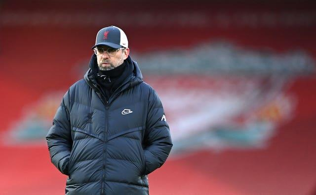 Liverpool manager Jurgen Klopp watches players warm up