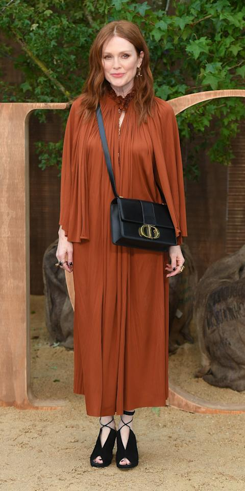 <p>Julianne Moore attended the Dior presentation in a burnt orange dress, Dior crossbody bag, and lace-up, peep-toe booties.</p>