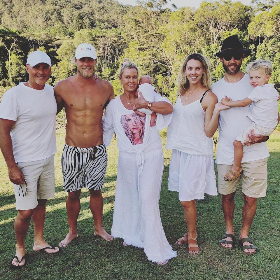 A photo of Lisa Curry with (from left) her ex-husband Grant Kenny, her son Jett, her daughter Morgan and son-in-law Ryan Gruell who is holding his son.