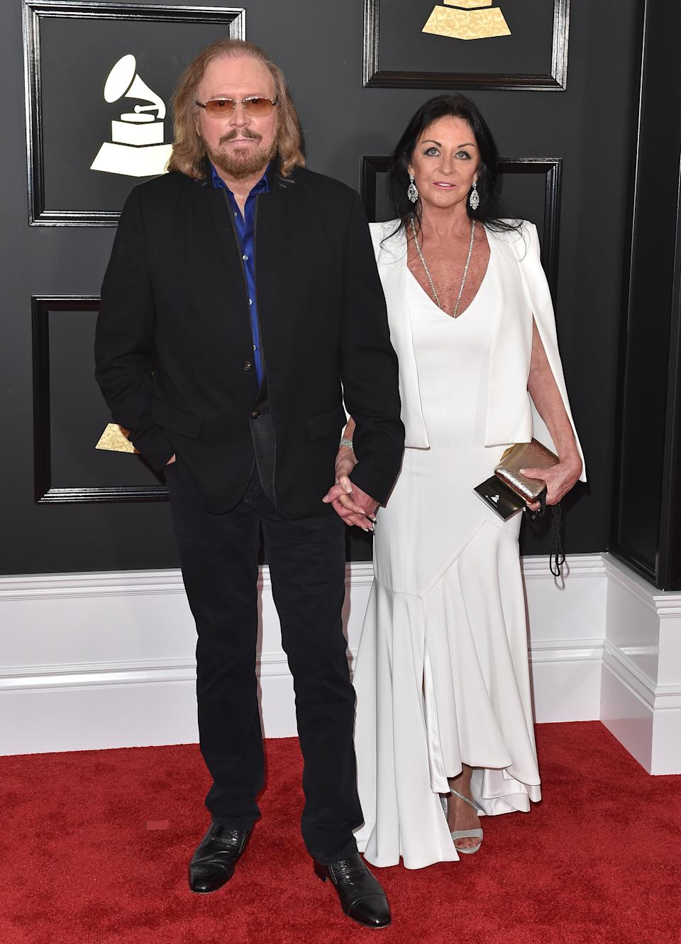 LOS ANGELES, CA - FEBRUARY 12: Singer Barry Gibb and Linda Gray attend the 59th GRAMMY Awards at STAPLES Center on February 12, 2017 in Los Angeles, California. (Photo by Axelle/Bauer-Griffin/FilmMagic)
