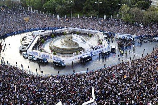 Real Madrid's players arrive on an open bus at Cibeles square in Madrid. Thousands of jubilant Real Madrid fans swamped the centre of the Spanish capital on Thursday to see their heroes parade in an open-top bus in celebration of their league title success