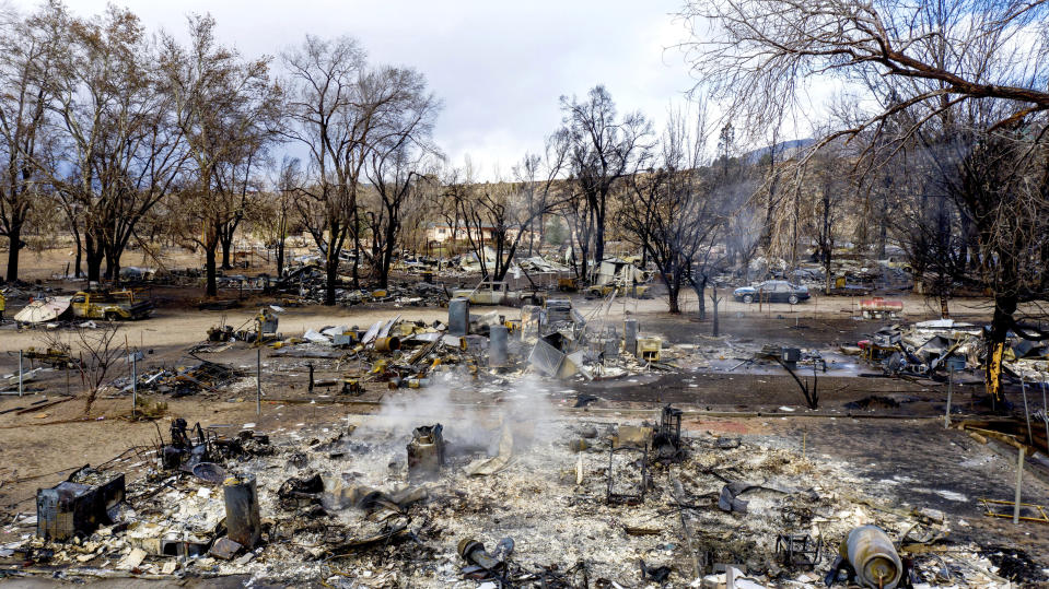 In this photo taken by a drone, residences leveled by the Mountain View Fire line a street in the Walker community in Mono County, Calif., Wednesday, Nov. 18, 2020. (AP Photo/Noah Berger)