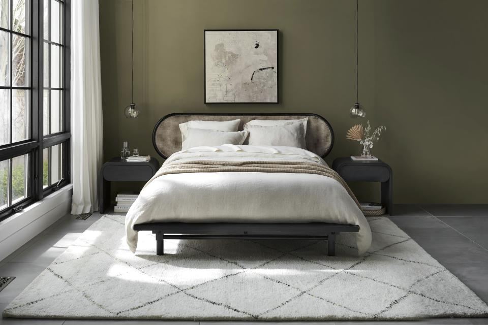 Two hot textural materials, rattan and jute, have moved from the porch and storage closet to just about every room in the home in the form of furniture and accessories. Crate & Barrel channels the 1930s with the curved-edge Anaise bedroom set. (Crate & Barrel via AP)