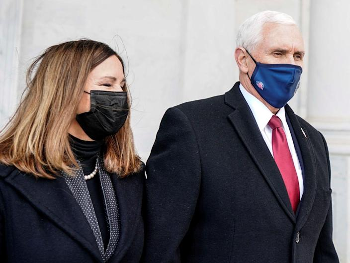 <p>Mike Pence attending Joe Biden's inauguration on 20 January</p> (REUTERS)