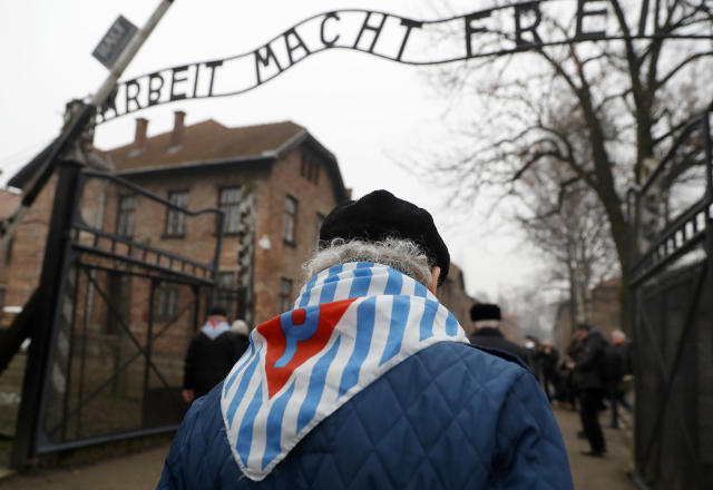 "<p>Survivors and guests walk past the ""Arbeit Macht Frei"" gate at the former Nazi German concentration and extermination camp Auschwitz, during the ceremonies marking the 73rd anniversary of the liberation of the camp and International Holocaust Victims Remembrance Day, in Oswiecim, Poland, Jan. 27, 2018. (Photo: Kacper Pempel/Reuters) </p>"