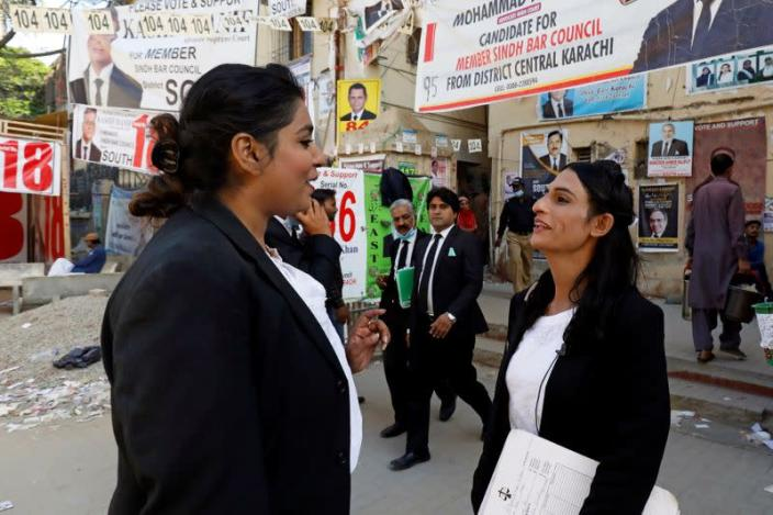Nisha Rao, 28, a transgender woman who became country's first practicing lawyer, shares a moment with her colleague at the district City Court in Karachi,