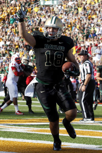 Baylor tight end Jordan Najvar (18) celebrates catching a touchdown pass during the first half of an NCAA college football game against Southern Methodist in Waco, Texas, Sunday, Sept. 2, 2012. (AP Photo/LM Otero)