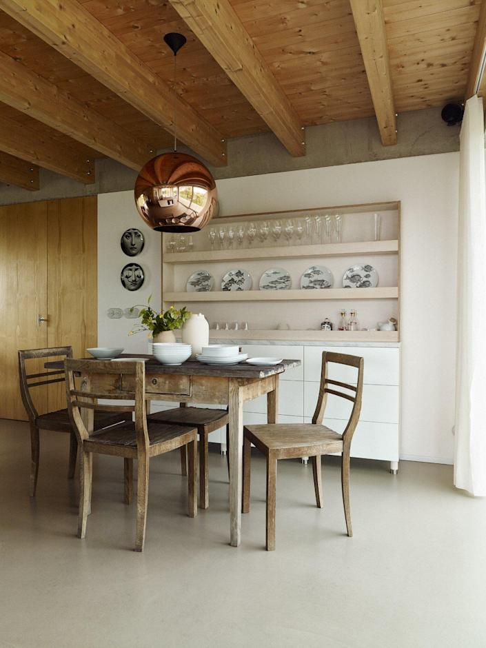 Inside the house itself, simple rustic furnishings and ample natural light are the stars of the show.