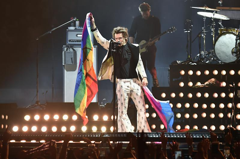 Harry Styles holds rainbow flags as he performs onstage during Harry Styles: Live On Tour - New York at Madison Square Garden on June 21, 2018 in New York City. (Photo by Kevin Mazur/Getty Images for HS)