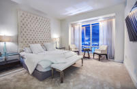 <p>A floor-to-ceiling headboard serves as the focal point in the master bedroom. A terrace overlooking the Miami skyline allows Krupa or Zago to take a mini escape at a moment's notice, making this the ultimate city pad in the sky.</p>