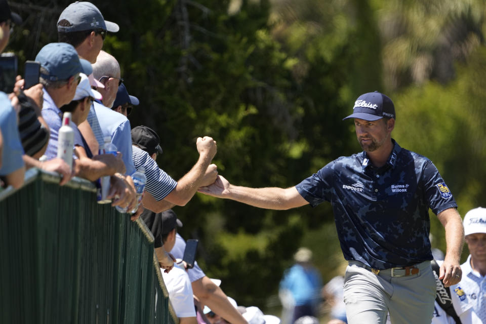 Webb Simpson greets fans as the walks to the second fairway during the first round of the PGA Championship golf tournament on the Ocean Course Thursday, May 20, 2021, in Kiawah Island, S.C. (AP Photo/David J. Phillip)
