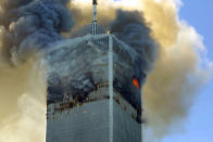 <p>Fire and smoke billows from the north tower of New York's World Trade Center on Tuesday, Sept. 11, 2001. (AP Photo/David Karp)</p>