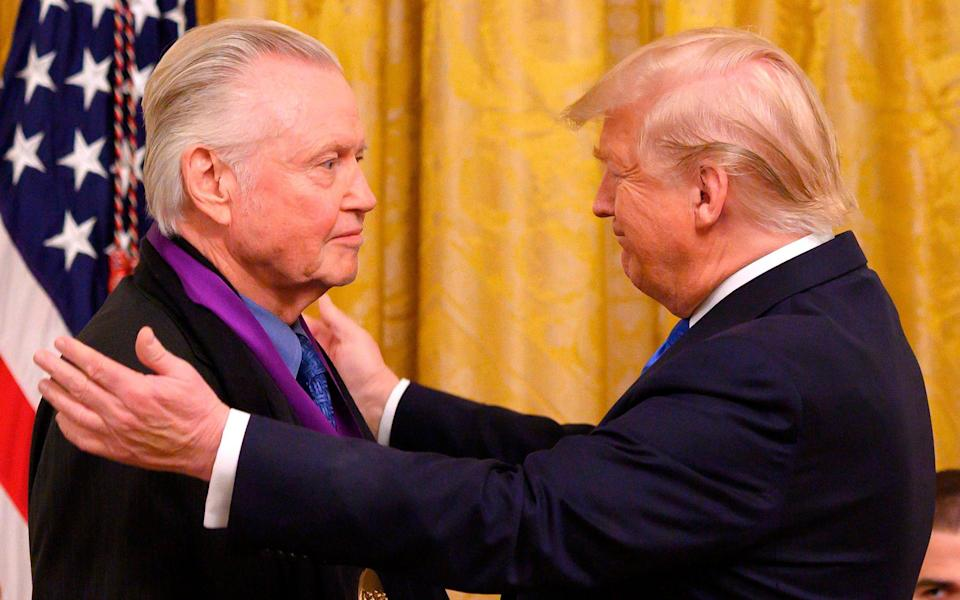 Jon Voight receives the National Medal of Arts from US President Donald Trump in 2019 - AFP