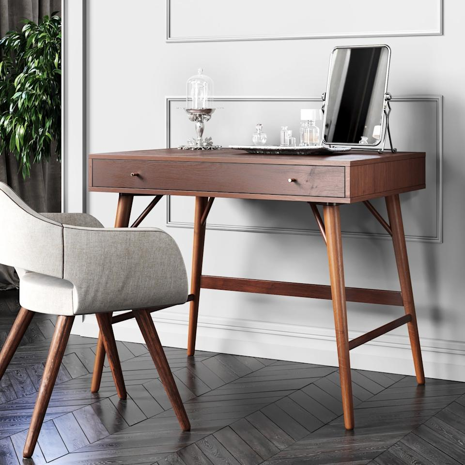 """<h3>Carson Carrington Palang Mid-Century Desk<br></h3> <br>When you're short in the square-footage department, make sure you opt for something fashionably functional like this simple but sleek MCM-style wooden desk that packs a storage-drawer bonus.<br><br><strong>Carson Carrington</strong> Palang Mid-Century Desk, $, available at <a href=""""https://go.skimresources.com/?id=30283X879131&url=https%3A%2F%2Fwww.overstock.com%2FHome-Garden%2FCarson-Carrington-Palang-Mid-century-Desk%2F30586194%2Fproduct.html"""" rel=""""nofollow noopener"""" target=""""_blank"""" data-ylk=""""slk:Overstock.com"""" class=""""link rapid-noclick-resp"""">Overstock.com</a>"""
