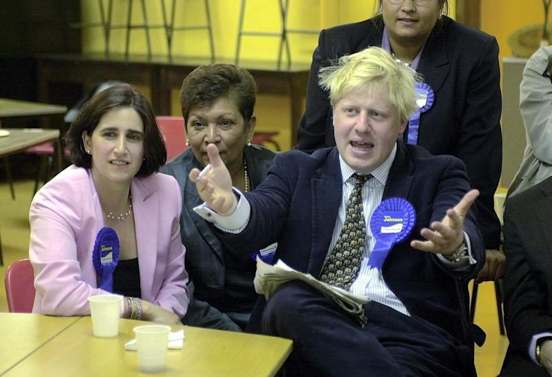 Boris Johnson watches the election results with wife Marina (l), in Watlington, Oxfordshire, after winning the Henley seat for the Conservatives in the 2001 General Election. (PA)