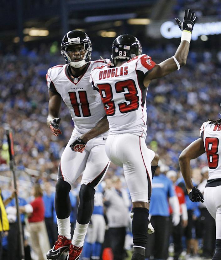 Atlanta Falcons wide receiver Julio Jones (11) celebrates his touchdown with wide receiver Harry Douglas (83) during the second quarter of an NFL football game against the Detroit Lions at Ford Field in Detroit, Saturday, Dec. 22, 2012. (AP Photo/Rick Osentoski)