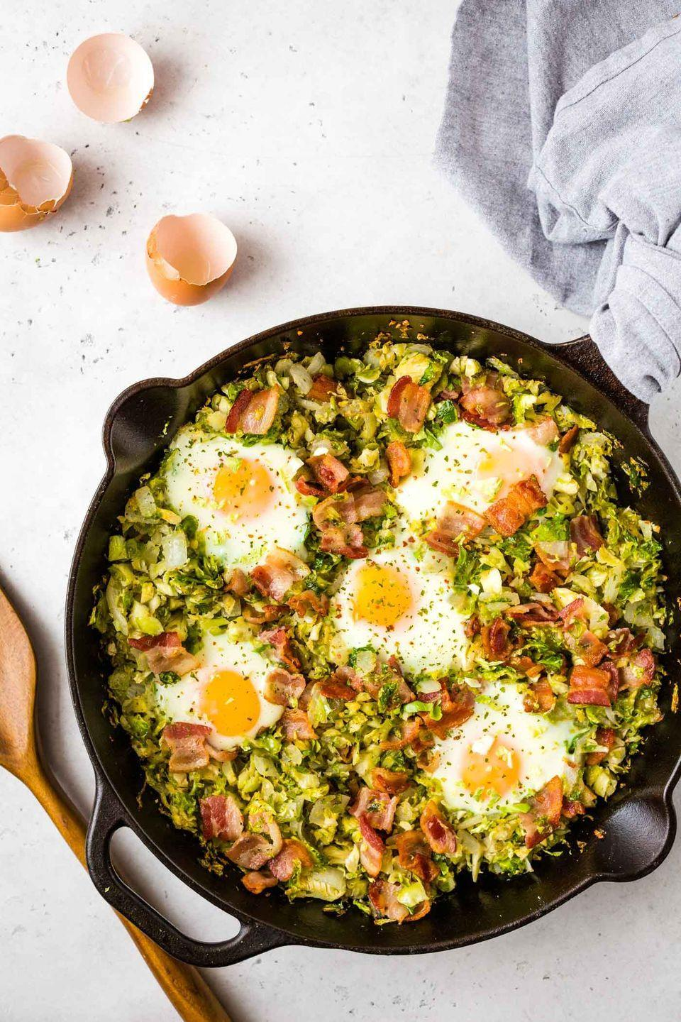 """<p>A healthy breakfast hash that includes bacon… yes, please! This carb-free recipe is loaded with protein and veggies. It will turn anyone into a Brussels sprouts fan.</p><p><strong>Get the recipe at <a href=""""https://thehealthyconsultant.com/brussels-sprouts-breakfast-hash-with-bacon/"""" rel=""""nofollow noopener"""" target=""""_blank"""" data-ylk=""""slk:The Healthy Consultant"""" class=""""link rapid-noclick-resp"""">The Healthy Consultant</a>.</strong></p><p><strong><a class=""""link rapid-noclick-resp"""" href=""""https://go.redirectingat.com?id=74968X1596630&url=https%3A%2F%2Fwww.walmart.com%2Fsearch%2F%3Fquery%3Dfood%2Bprocessor%26typeahead%3Dfood%2Bproce&sref=https%3A%2F%2Fwww.thepioneerwoman.com%2Ffood-cooking%2Fmeals-menus%2Fg34922086%2Fhealthy-breakfast-ideas%2F"""" rel=""""nofollow noopener"""" target=""""_blank"""" data-ylk=""""slk:SHOP FOOD PROCESSORS"""">SHOP FOOD PROCESSORS</a><br></strong></p>"""