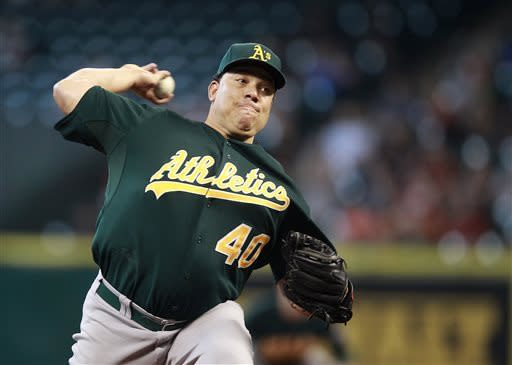 Oakland Athletics pitcher Bartolo Colon throws in the first inning during a baseball game against the Houston Astros, Sunday, May 26, 2013, in Houston. (AP Photo/Patric Schneider)