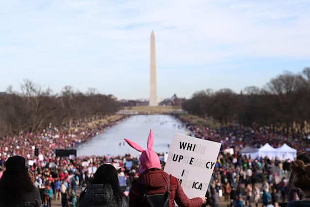 <p>People gather at the Lincoln Memorial reflecting pool to rally before the Women's March on Jan. 20, 2018 in Washington, D.C. (Photo: Alex Wroblewski/Getty Images) </p>