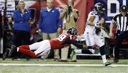 Seattle Seahawks wide receiver Golden Tate (81) gets past Atlanta Falcons free safety Thomas DeCoud (28) for a touchdown reception during the second half of an NFC divisional playoff NFL football game Sunday, Jan. 13, 2013, in Atlanta. (AP Photo/David Goldman)