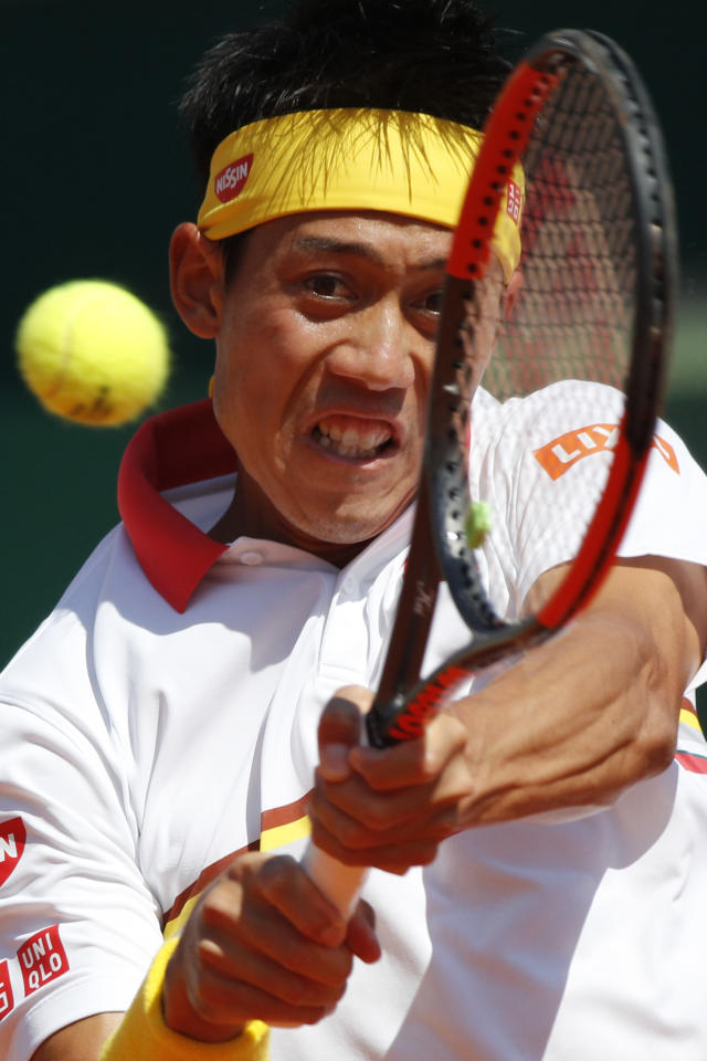 Japan's Kei Nishikori returns against Spain's Rafael Nadal during the men's singles final match of the Monte Carlo Tennis Masters tournament in Monaco, Sunday April 22, 2018. (AP Photo/Christophe Ena)