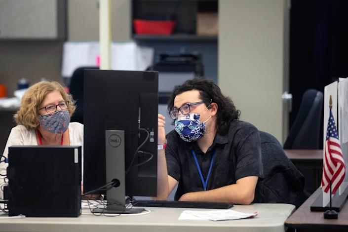A bipartisan pair of ballot analysts at the Maricopa County Recorder's Office in Phoenix on Nov. 5, 2020.
