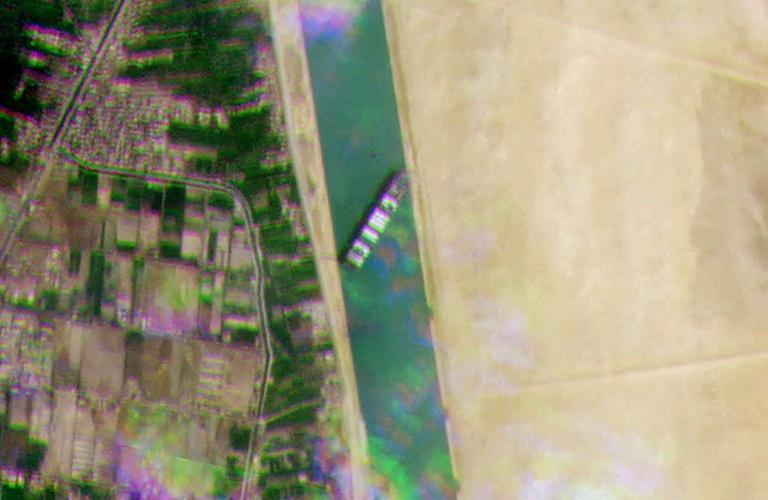 A satellite image released by Planet Labs Inc shows the Taiwan-owned MV 'Ever Given' container ship, wedged sideways and impeding all traffic across the Suez Canal