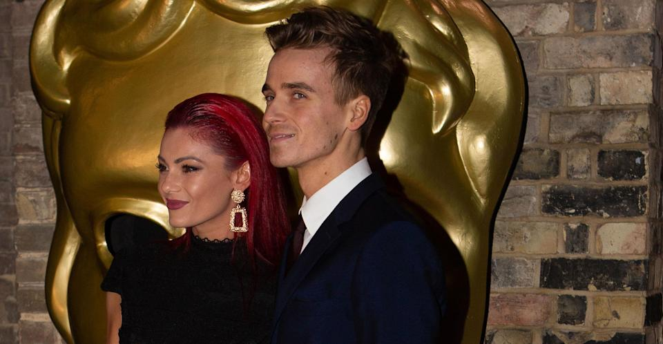 "<p>And yet another romance emerged on <em>Strictly Come Dancing. </em>27-year-old vlogger <a rel=""nofollow"" href=""https://uk.news.yahoo.com/joe-sugg-revealed-romance-strictly-come-dancing-partner-dianne-buswell-095703037.html"" data-ylk=""slk:Joe Sugg has finally confirmed he is indeed in a relationship with his Strictly pro partner Dianne Buswell;outcm:mb_qualified_link;_E:mb_qualified_link;ct:story;"" class=""link rapid-noclick-resp yahoo-link"">Joe Sugg has finally confirmed he is indeed in a relationship with his <em>Strictly </em>pro partner Dianne Buswell</a>. The 29-year-old red-haired Aussie reportedly <a rel=""nofollow"" href=""https://uk.news.yahoo.com/strictly-curse-joe-suggs-partner-dianne-buswell-splits-emmerdale-actor-boyfriend-103106183.html?bcmt=1"" data-ylk=""slk:dumped her Emmerdale;outcm:mb_qualified_link;_E:mb_qualified_link;ct:story;"" class=""link rapid-noclick-resp yahoo-link"">dumped her <em>Emmerdale </em></a>actor boyfriend Anthony Quinlan just weeks into the show for Sugg. </p>"