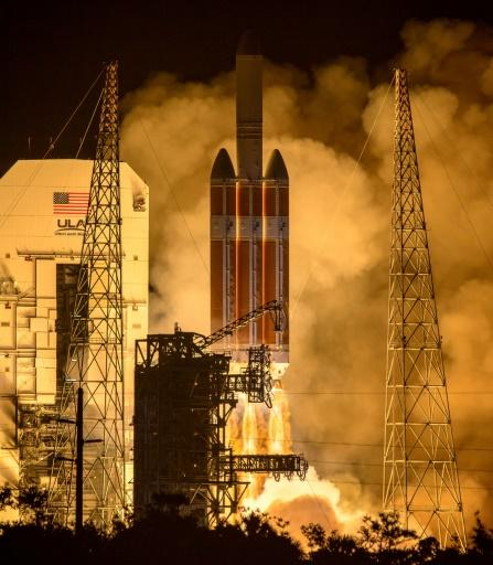 Photo released by NASA shows the United Launch Alliance Delta IV Heavy rocket with the Parker Solar Probe aboard launching from the Mobile Service Tower at Launch Complex 37, Cape Canaveral Air Force Station in Florida on August 12, 2018
