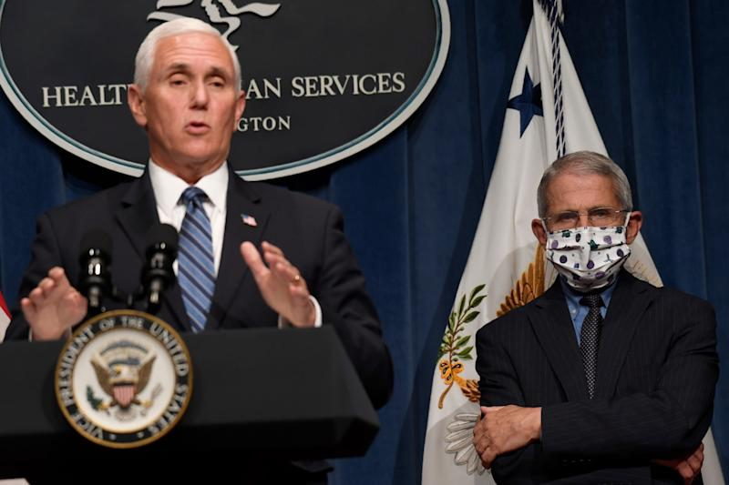 Mike Pence speaks at a briefing by the coronavirus task force as Anthony Fauci looks on: AP