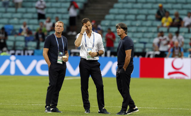 From left, Germany goalkeepers coach Andreas Koepke, team manager Oliver Bierhoff and head coach Joachim Loew stand on the pitch prior to the start of the group F match between Germany and Sweden at the 2018 soccer World Cup in the Fisht Stadium in Sochi, Russia, Saturday, June 23, 2018. (AP Photo/Frank Augstein)