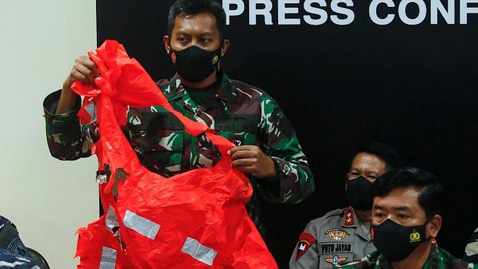An escape suit believed to be from the sunken Indonesian Navy KRI Nanggala submarine is shown at a news conference in Bali, Indonesia, April 25, 2021