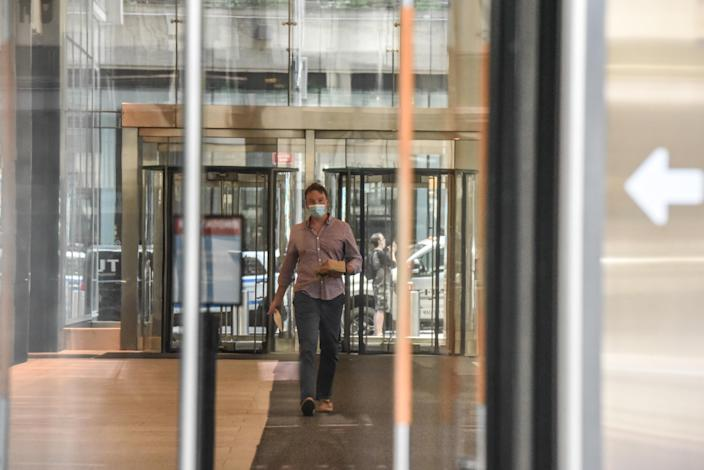 A person walks through an office building lobby on June 22, 2020 in the Midtown neighborhood in New York City. (Photo by Stephanie Keith/Getty Images)