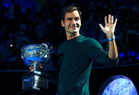 Tennis - Australian Open - Melbourne Park, Melbourne, Australia, January 11, 2018. Switzerland's Roger Federer holds the Men's singles trophy as he participates in the official draw ceremony ahead of the Australian Open tennis tournament. REUTERS/David Gray