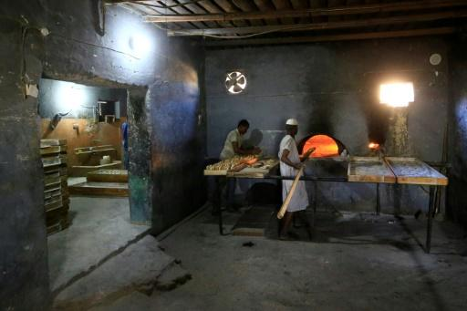 Sudanese bakers prepare loaves in Atbara, the cradle of protests against the price of bread this time last year which eventually brought the downfall of President Omar al-Bashir in April