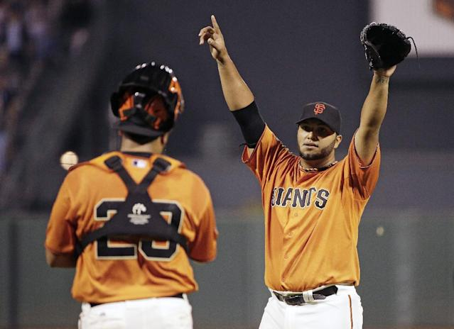 San Francisco Giants starting pitcher Yusmeiro Petit, right, reacts on the mound in front of catcher Hector Sanchez at the end of their baseball game against the Arizona Diamondbacks on Friday, Sept. 6, 2013, in San Francisco. San Francisco won the game 3-0 and Petit pitched a one-hitter. (AP Photo/Eric Risberg)