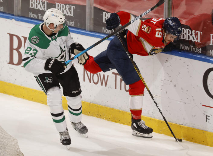 Dallas Stars defenseman Esa Lindell (23) checks Florida Panthers left wing Mason Marchment (19) off the puck during the second period of an NHL hockey game, Monday, May 3, 2021, in Sunrise, Fla. (AP Photo/Joel Auerbach)