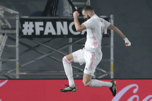 Real Madrid's Karim Benzema celebrates scoring his side's second goal during the Spanish La Liga soccer match between Real Madrid and Granada at the Alfredo Di Stefano stadium in Madrid, Spain, Wednesday, Dec. 23, 2020. (AP Photo/Bernat Armangue)