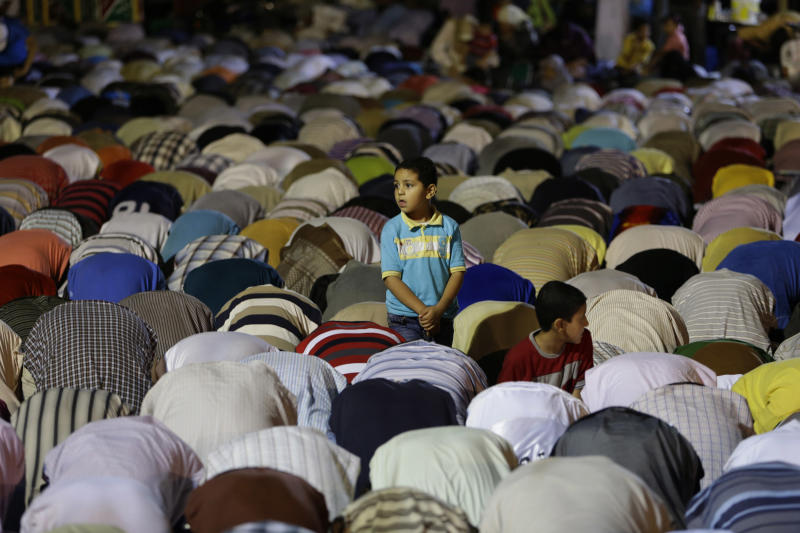 An Egyptian boy stands among the supporters of ousted Egypt's President Mohammed Morsi, who are offering the the Tarawih prayer, after the evening meal when Muslims break their fast during the Islamic month of Ramadan, in Nasr City, Cairo, Egypt, Wednesday July 10, 2013. Egypt's military-backed government tightened a crackdown on the Muslim Brotherhood on Wednesday, ordering the arrest of its revered leader in a bid to choke off the group's campaign to reinstate President Mohammed Morsi one week after an army-led coup. (AP Photo/Hussein Malla)