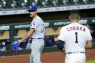 Los Angeles Dodgers relief pitcher Joe Kelly (17) looks back at Houston Astros' Carlos Correa (1) after the sixth inning of a baseball game Tuesday, July 28, 2020, in Houston. Both benches emptied during the exchange. (AP Photo/David J. Phillip)
