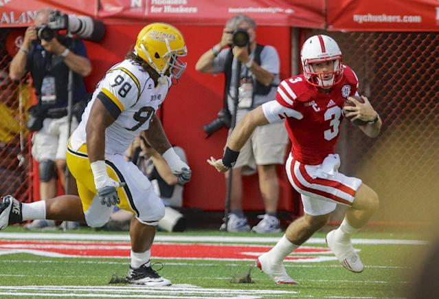 Nebraska quarterback Taylor Martinez (3) is pursued by Southern Mississippi defensive lineman Khyri Thornton (98) in the first half of an NCAA college football game in Lincoln, Neb., Saturday, Sept. 7, 2013. (AP Photo/Nati Harnik)