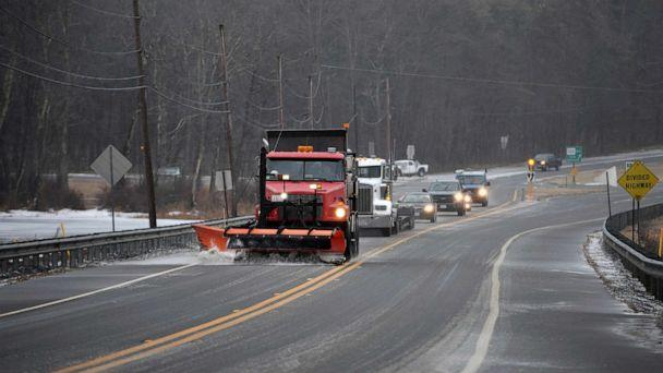 PHOTO: A plow and salter leads cars in the inclement weather, in Rutland, Mass., Dec. 30, 2019. A combination of freezing rain and snow has hit parts of northern New England. (Christine Peterson/Worcester Telegram & Gazette via AP)