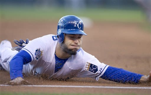 Kansas City Royals' Eric Hosmer slides into third base during the second inning of a baseball game against the Cleveland Indians at Kauffman Stadium in Kansas City, Mo., Saturday, Sept. 22, 2012. (AP Photo/Orlin Wagner)
