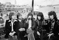 <p>Mick Jagger, Charlie Watts, Keith Richards, Bill Wyman, and Mick Taylor on a boat during their tour of Germany in 1970.</p>
