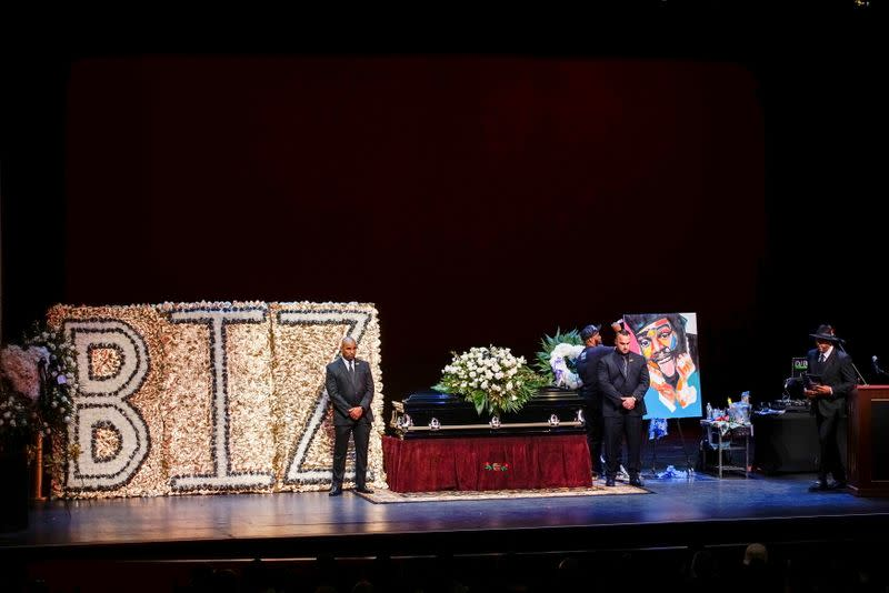 People stand guard next to the casket for late rapper Marcel Theo Hall, known by his stage name Biz Markie, during the funeral service in Patchogue, New York
