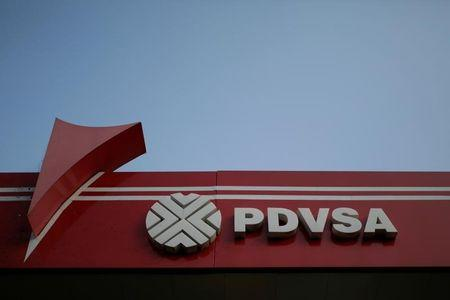 FILE PHOTO - The corporate logo of the state oil company PDVSA is seen at a gas station in Caracas, Venezuela April 12, 2017. REUTERS/Marco Bello
