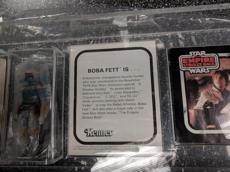 Consumers who sent in their proof-of-purchase rebate would receive a Boba Fett figurine with this insert from Cincinnatti-based Kenner toys explaining the character's backstory. In 1979, Kenner pulled the Boba Fett J-slot rocket firing backpack prototype due to a potential chocking hazard. The action figure was replaced with a Boba Fett and solid, non-mechanical backpack. The J-slot prototype is up for auction at Hake's in York; the toy is expected to sell for close to $250,000.